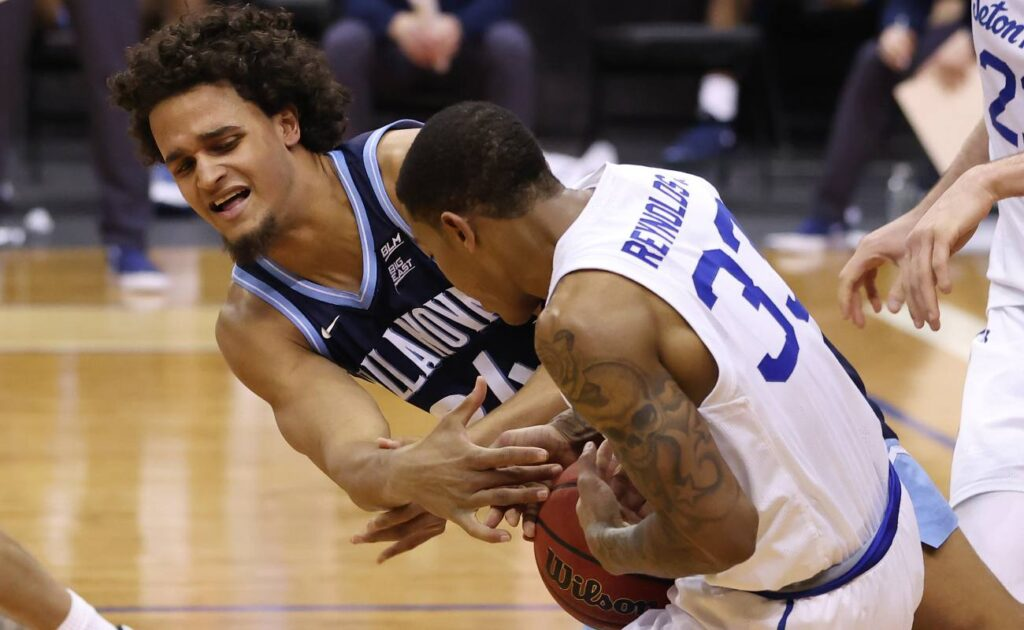 NEWARK, NJ - JANUARY 30: Jeremiah Robinson-Earl #24 of the Villanova Wildcats battles Shavar Reynolds, Jr. #33 of the Seton Hall Pirates for the ball during the second half of an NCAA college basketball game at Prudential Center on January 30, 2021 in Newark, New Jersey. Villanova defeated Seton Hall 80-72. (Photo by Rich Schultz/Getty Images)