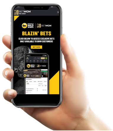 A right hand holding a smartphone with the Buffalo Wild Wings x BetMGM offer on the screen