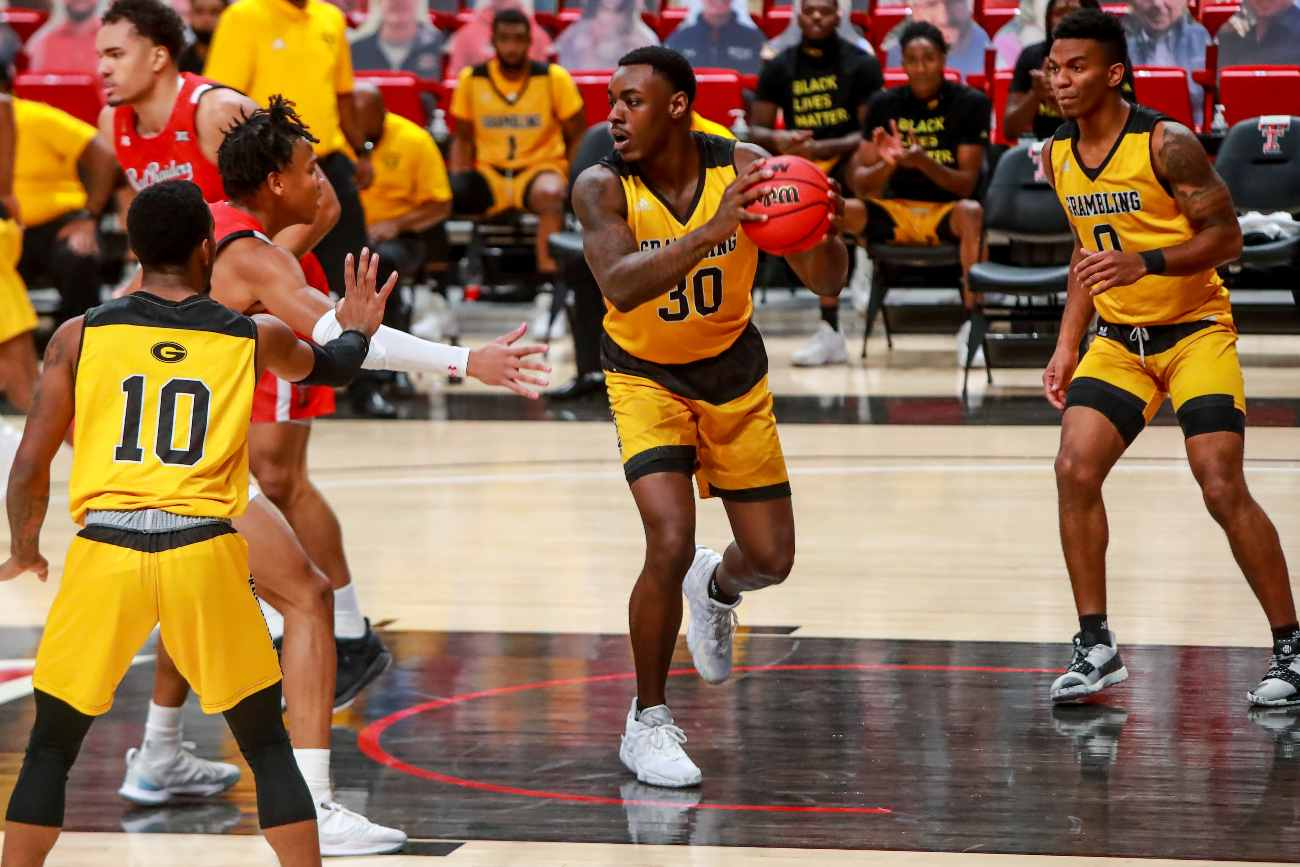 LUBBOCK, TEXAS - DECEMBER 06: Forward Brian Thomas #30 of the Grambling State Tigers handles the ball during the first half of the college basketball game against the Texas Tech Red Raiders at United Supermarkets Arena on December 06, 2020 in Lubbock, Texas. (Photo by John E. Moore III/Getty Images)