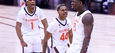 Kofi Cockburn #21 of the Illinois Fighting Illini celebrates with his teammates after a dunk against the Rutgers Scarlet Knights during the first half of the Big Ten men's basketball tournament quarterfinals at Lucas Oil Stadium on March 12, 2021 in Indianapolis, Indiana. (Photo by Justin Casterline/Getty Images)