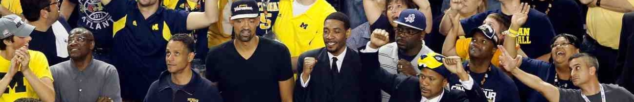 ATLANTA, GA - APRIL 08: Former Michigan Wolverines players Juwan Howard, Jimmy King, Ray Jackson and Jalen Rose cheer on the Wolverines as they take on the Louisville Cardinals during the 2013 NCAA Men's Final Four Championship at the Georgia Dome on April 8, 2013 in Atlanta, Georgia. (Photo by Kevin C. Cox/Getty Images)