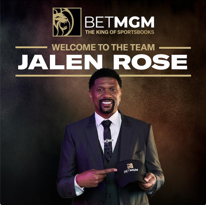 """Jalen Rose holding a BetMGM cap on a dark background with th eBetMGM logo on top and the words"""" Welcome to the team, Jalen Rose"""""""
