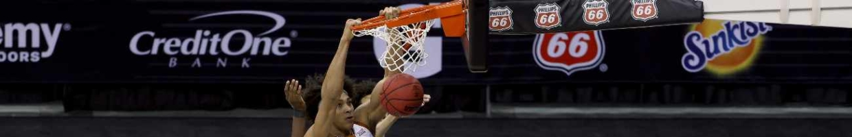 KANSAS CITY, MISSOURI - MARCH 13: Jericho Sims #20 of the Texas Longhorns dunks during the Longhorns' 91-86 victory over the Oklahoma State Cowboys in the Big 12 Basketball Tournament championship game at the T-Mobile Center on March 13, 2021 in Kansas City, Missouri. (Photo by Jamie Squire/Getty Images)