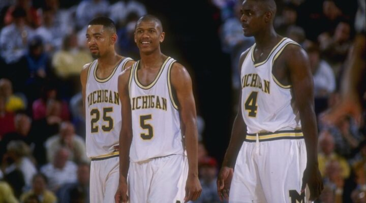8 Mar 1992: Michigan Wolverines forward Juwan Howard, guard Jalen Rose, and forward Chris Webber (l to r) look on during a game against the Indiana Pacerss (Getty Images)
