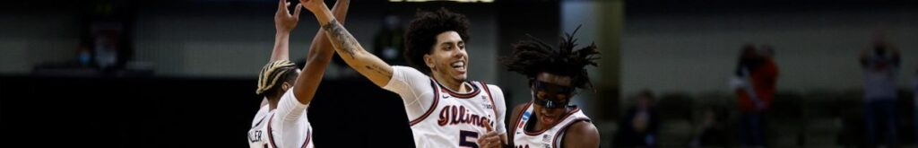 Adam Miller #44, Andre Curbelo #5, and Ayo Dosunmu #11 of the Illinois Fighting Illini celebrate against the Drexel Dragons in the second half of the first round game of the 2021 NCAA Men's Basketball Tournament at Indiana Farmers Coliseum on March 19, 2021 in Indianapolis, Indiana. (Photo by Maddie Meyer/Getty Images)
