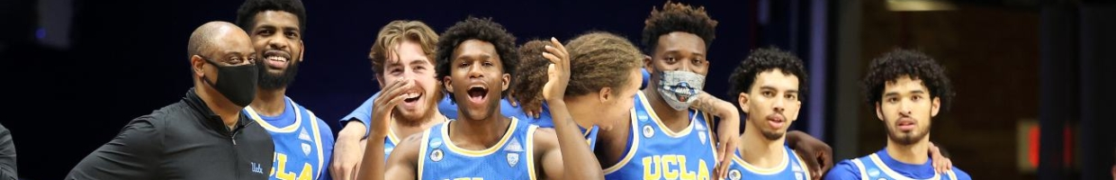 David Singleton #34 and the UCLA Bruins react in the final moments of their 73-62 win over the Brigham Young Cougars in the first round game of the 2021 NCAA Men's Basketball Tournament at Hinkle Fieldhouse on March 20, 2021 in Indianapolis, Indiana. (Photo by Andy Lyons/Getty Images)