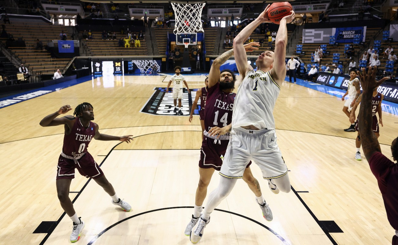 Hunter Dickinson #1 of the Michigan Wolverines shoots against Chris Baldwin #14 of the Texas Southern Tigers during the second half in the first round game of the 2021 NCAA Men's Basketball Tournament at Mackey Arena on March 20, 2021 in West Lafayette, Indiana.