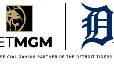 betmgm logo next to the detroit tigers logo on a white background