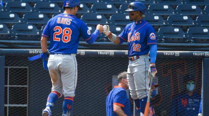 J.D. Davis #28 of the New York Mets is congratulated by Francisco Lindor #12 after scoring in the sixth inning of a spring training game against the Washington Nationals at The Ballpark of The Palm Beaches on March 21, 2021, in West Palm Beach, Florida. (Photo by Eric Espada/Getty Images)
