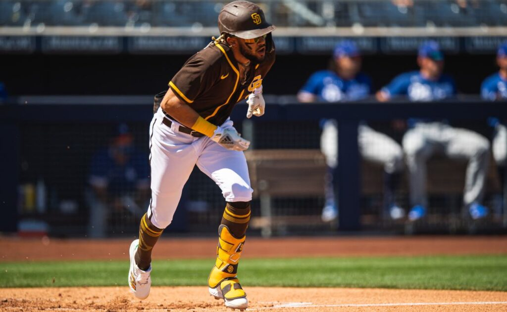 PEORIA, AZ - MARCH 20: Infielder Fernando Tatis Jr. #23 of the San Diego Padres runs down the first baseline against the Los Angeles Dodgers at the Peoria Sports Complex on March 20, 2021 in Peoria, Arizona. (Photo by Matt Thomas/San Diego Padres/Getty Images)
