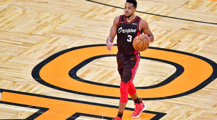 CJ McCollum #3 of the Portland Trail Blazers dribbles during the second half against the Orlando Magic at Amway Center on March 26, 2021 in Orlando, Florida. (Photo by Julio Aguilar/Getty Images)