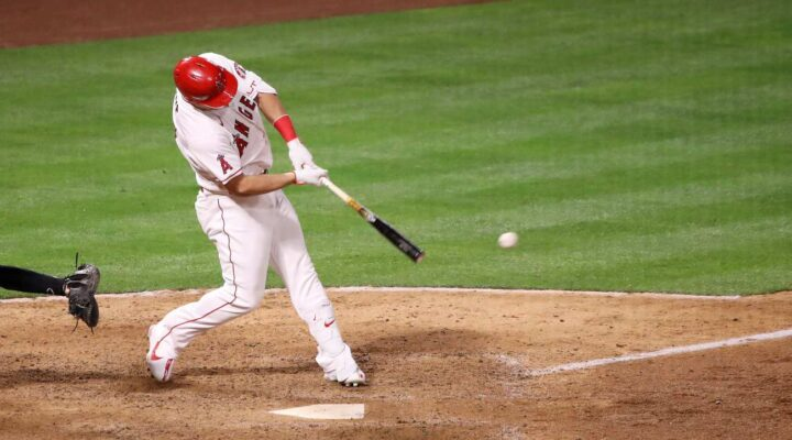 ANAHEIM, CALIFORNIA - APRIL 01: Mike Trout #27 of the Los Angeles Angels hits an hits an RBI single against the Chicago White Sox during the eighth inning on Opening Day at Angel Stadium of Anaheim on April 01, 2021 in Anaheim, California. (Photo by Katelyn Mulcahy/Getty Images)