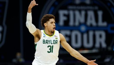 MaCio Teague #31 of the Baylor Bears reacts after making a three point basket against the Arkansas Razorbacks during the second half in the Elite Eight round of the 2021 NCAA Men's Basketball Tournament at Lucas Oil Stadium on March 29, 2021 in Indianapolis, Indiana. (Photo by Tim Nwachukwu/Getty Images)