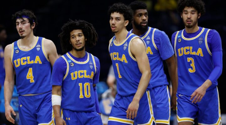 The UCLA Bruins react during the second half against the Michigan Wolverines in the Elite Eight round game of the 2021 NCAA Men's Basketball Tournament at Lucas Oil Stadium on March 30, 2021 in Indianapolis, Indiana. (Photo by Jamie Squire/Getty Images)