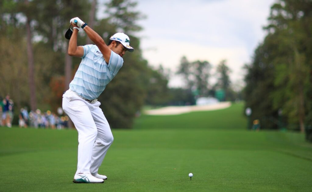 Hideki Matsuyama of Japan plays his shot from the 18th tee during the third round of the Masters at Augusta National Golf Club on April 10, 2021 in Augusta, Georgia. (Photo by Mike Ehrmann/Getty Images)