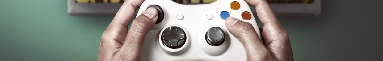 Person playing a basketball video game with a white controller.