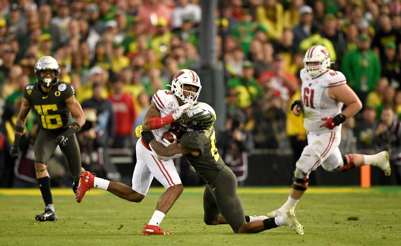 PASADENA, CALIFORNIA - JANUARY 01: Kendric Pryor #3 of the Wisconsin Badgers runs with the ball against Jevon Holland #8 of the Oregon Ducks during the third quarter in the Rose Bowl game presented by Northwestern Mutual at Rose Bowl on January 01, 2020 in Pasadena, California. (Photo by Kevork Djansezian/Getty Images)