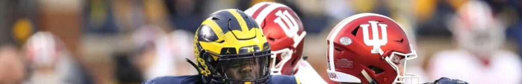ANN ARBOR, MICHIGAN - NOVEMBER 17: Kwity Paye #19 of the Michigan Wolverines tries to sack Peyton Ramsey #12 of the Indiana Hoosiers at Michigan Stadium on November 17, 2018 in Ann Arbor, Michigan. Michigan won the game 31-20. (Photo by Gregory Shamus/Getty Images)