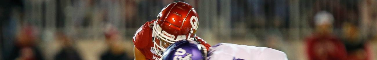 NORMAN, OK - NOVEMBER 23: Wide receiver Jadon Haselwood #11 of the Oklahoma Sooners gets drilled by safety Trevon Moehrig #7 of the TCU Horned Frogs for a fumble and turnover in the second quarter on November 23, 2019 at Gaylord Family Oklahoma Memorial Stadium in Norman, Oklahoma. OU held on to win 28-24. (Photo by Brian Bahr/Getty Images)