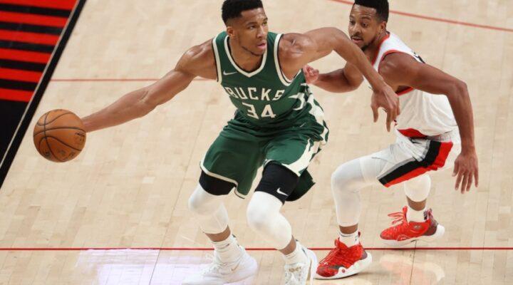 Giannis Antetokounmpo #34 of the Milwaukee Bucks works against CJ McCollum #3 of the Portland Trail Blazers in the third quarter at Moda Center on April 02, 2021 in Portland, Oregon.