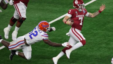ARLINGTON, TEXAS - DECEMBER 30: Quarterback Spencer Rattler #7 of the Oklahoma Sooners runs against the Florida Gators during the second half at AT&T Stadium on December 30, 2020 in Arlington, Texas. (Photo by Carmen Mandato/Getty Images)