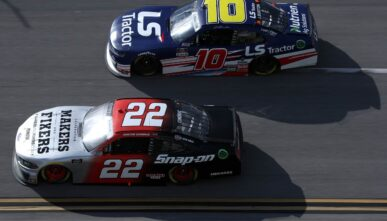 TALLADEGA, ALABAMA - APRIL 24: Austin Cindric, driver of the #22 Snap-On Ford, and Jeb Burton, driver of the #10 LS Tractors Chevrolet, race during the NASCAR Xfinity Series Ag-Pro 300 at Talladega Superspeedway on April 24, 2021 in Talladega, Alabama. (Photo by Sean Gardner/Getty Images)