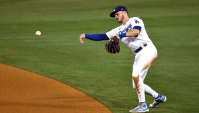 LOS ANGELES, CALIFORNIA - MAY 12: Gavin Lux #9 of the Los Angeles Dodgers makes a throw to first base against the Seattle Mariners during the eighth inning at Dodger Stadium on May 12, 2021 in Los Angeles, California. (Photo by Michael Owens/Getty Images)