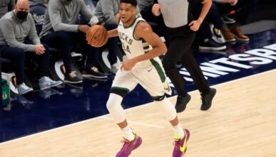 Giannis Antetokounmpo #34 of the Milwaukee Bucks brings the ball up the court in the game against the Indiana Pacers during the first quarter at Bankers Life Fieldhouse on May 13, 2021 in Indianapolis, Indiana.