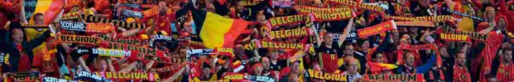 Fans in a stadium holding up scarves for Belgium and Scotland - Photo credit ANDY BUCHANAN/AFP via Getty Images
