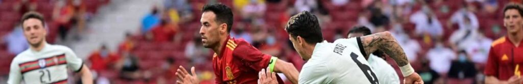 Spain's midfielder Sergio Busquets (L) is challenged by Portugal's defender Jose Fonte during the international friendly football match between Spain and Portugal at the Wanda Metropolitano stadium in Madrid in preparation for the UEFA European Championships, on June 4, 2021. (Photo by JAVIER SORIANO/AFP via Getty Images)