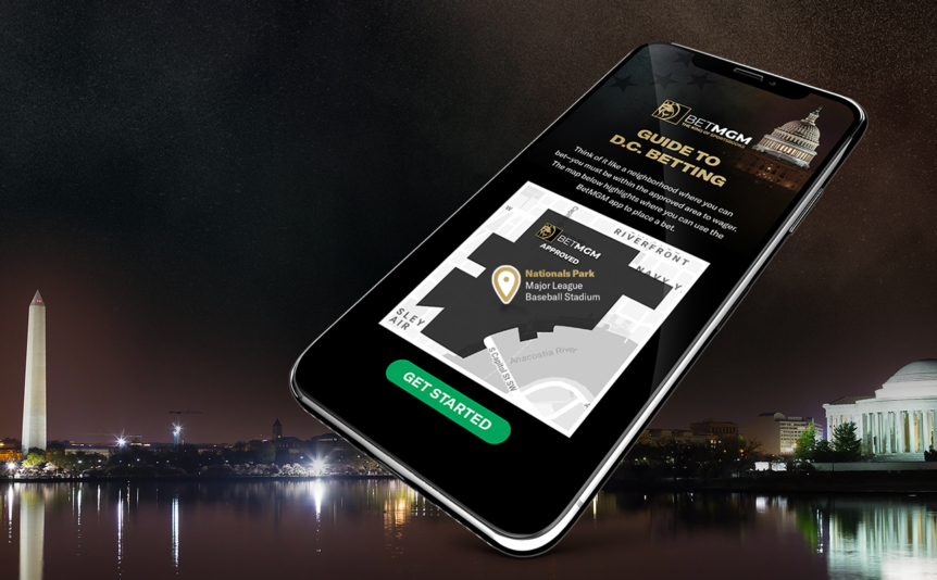 BetMGM DC app showing on a smartphone with Washington DC skyline in the background