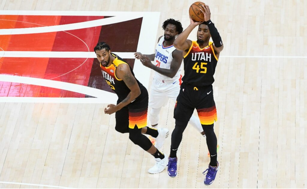 Donovan Mitchell #45 of the Utah Jazz shoots over Paul George #13 of the LA Clippers in Game Two of the Western Conference second-round playoff series at Vivint Smart Home Arena on June 10, 2021 in Salt Lake City, Utah. (Photo by Alex Goodlett/Getty Images)