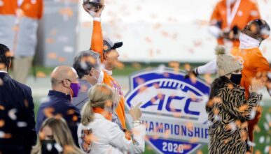Head coach Dabo Swinney of the Clemson Tigers holds the trophy after defeating the Notre Dame Fighting Irish 34-10 in the ACC Championship game at Bank of America Stadium on Dec. 19, 2020, in Charlotte, North Carolina. (Photo by Jared C. Tilton/Getty Images)