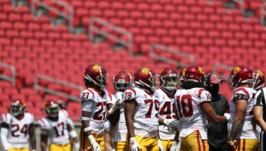 The USC Trojans defensive players huddle during the spring game at Los Angeles Coliseum on April 17, 2021, in Los Angeles. (Photo by Meg Oliphant/Getty Images)