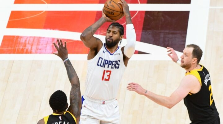 Paul George #13 of the LA Clippers shoots over Royce O'Neale #23 of the Utah Jazz in Game Two of the Western Conference second-round playoff series at Vivint Smart Home Arena on June 10, 2021 in Salt Lake City, Utah. (Photo by Alex Goodlett/Getty Images)