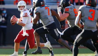 Iowa State quarterback Brock Purdy escapes pressue put on by the Oklahoma State defense on Oct. 24, 2020. (Photo by Brian Bahr/Getty Images)