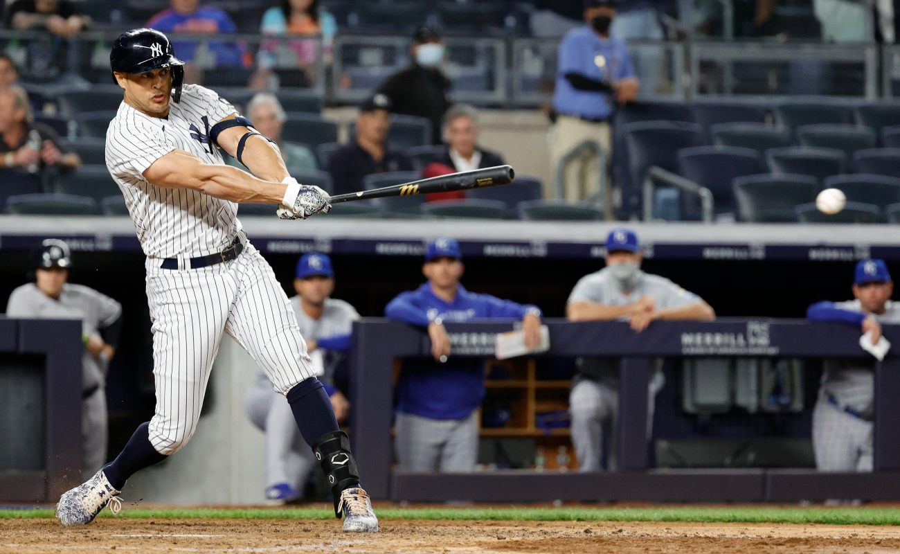 Giancarlo Stanton #27 of the New York Yankees hits a single during the ninth inning against the Kansas City Royals at Yankee Stadium on June 23, 2021 in the Bronx borough of New York City.