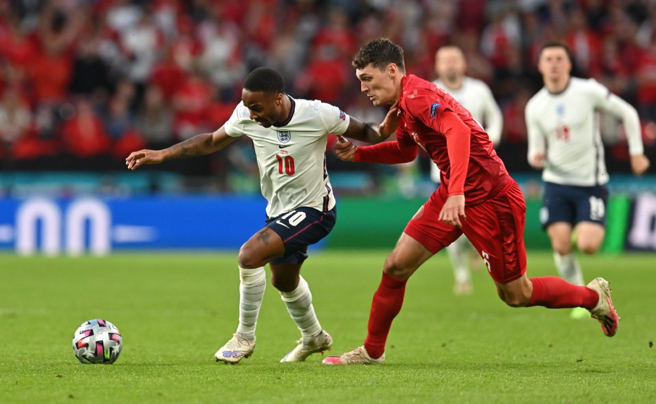 Raheem Sterling of England battles for possession with Andreas Christensen of Denmark during the UEFA Euro 2020 Championship Semi-final match between England and Denmark at Wembley Stadium on July 07, 2021 in London, England.