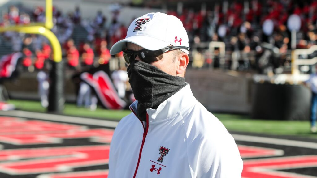 LUBBOCK, TEXAS - OCTOBER 24: Head coach Matt Wells of the Texas Tech Red Raiders walks onto the field before the college football game against the West Virginia Mountaineers on October 24, 2020 at Jones AT&T Stadium in Lubbock, Texas. (Photo by John E. Moore III/Getty Images)