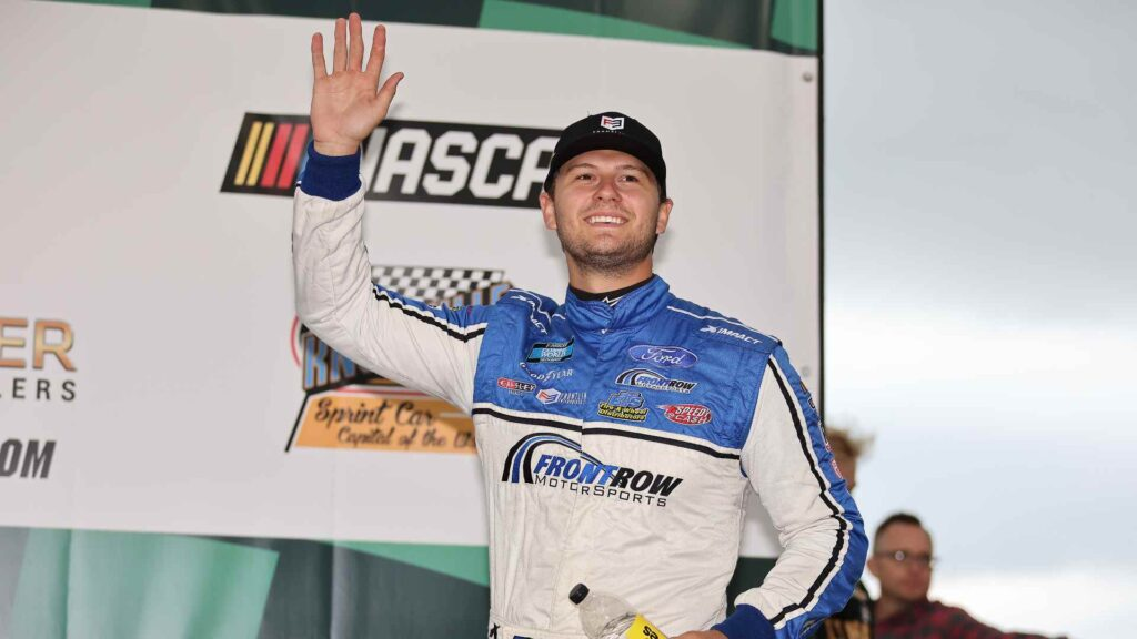 KNOXVILLE, IOWA – JULY 09: Todd Gilliland, driver of the #38 Frontline Enterprises Inc. Ford, waves to fans during driver intros prior to the NASCAR Camping World Truck Series Corn Belt 150 presented by Premier Chevy Dealers at Knoxville Raceway on July 09, 2021 in Knoxville, Iowa.